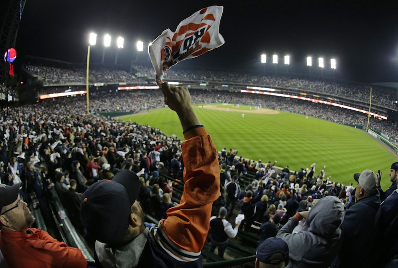 A Detroit Tigers fan cheers before the start of Game 5 of the American League baseball championship series against the Boston Red Sox, Thursday, Oct. 17, 2013, in Detroit.