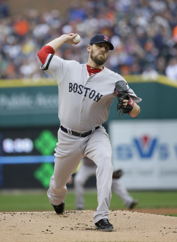 Red Sox starting pitcher John Lackey throws in the first inning during Game 3 of the American League baseball championship series Tuesday.