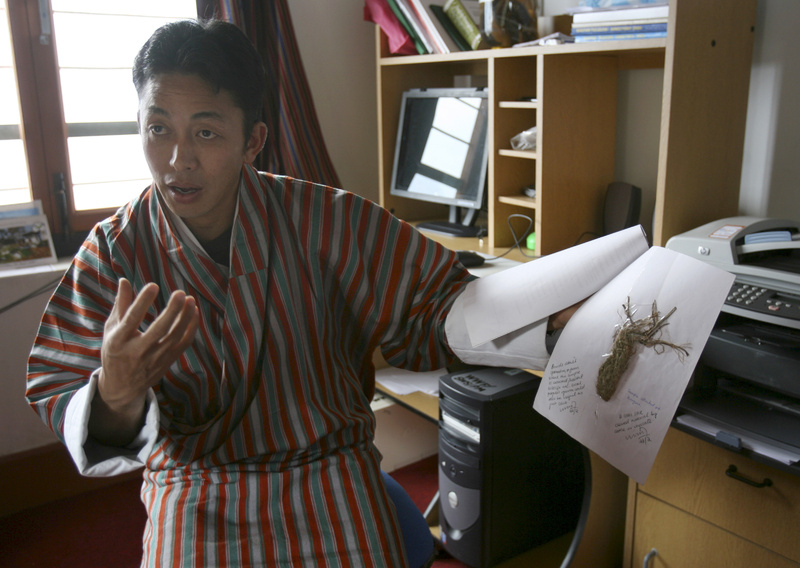 The manager of Sakteng Wildlife Sanctuary, Tenzing Wangchuck, shows a specimen collected from the park by Yeti watchers at Phongme, Bhutan. A hair sample from Bhutan was one of two analyzed by a British scientist who developed a theory about Yetis.