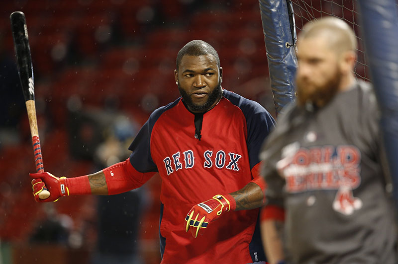 Boston Red Sox's David Ortiz walks into the batting cage during a workout at Fenway Park Tuesday, Oct. 22, 2013, in Boston. The Red Sox are scheduled to host the St. Louis Cardinals in Game 1 of baseball's World Series on Wednesday. MLB