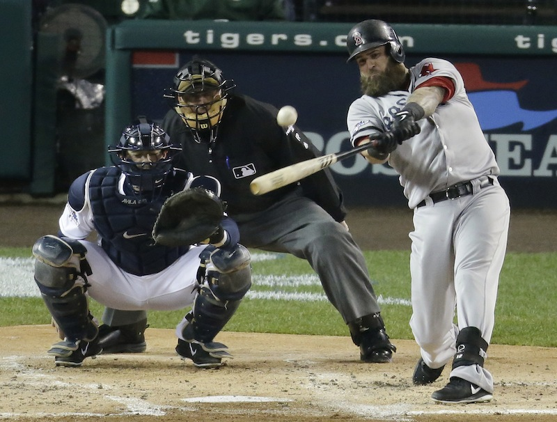 Boston Red Sox's Mike Napoli hits a home run in the second inning during Game 5 of the American League baseball championship series against the Detroit Tigers, Thursday, Oct. 17, 2013, in Detroit.
