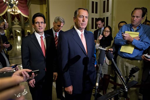 House Majority Leader Rep. Eric Cantor, R-Va., left, and House Majority Whip Rep. Kevin McCarthy, R-Calif., rear center, look on as Speaker of the House Rep. John Boehner, R-Ohio, pauses during a news conference on Capitol Hill on Tuesday in Washington. Congress was unable to reach a midnight deadline to keep the government funded, triggering the first government shutdown in more than 17 years.