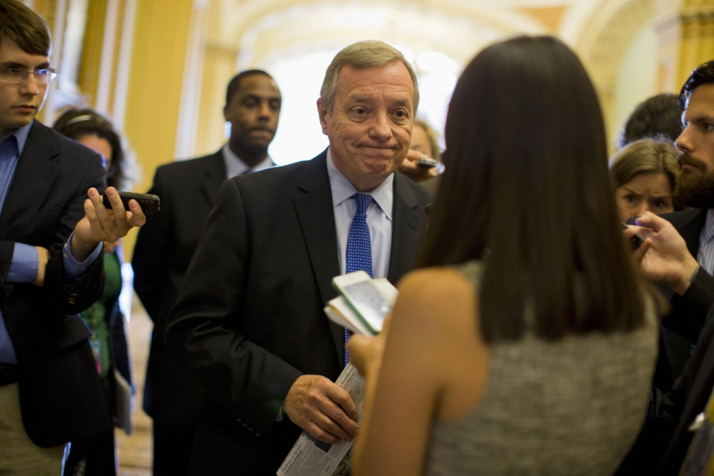 Senate Majority Whip Richard Durbin of Illinois talks with reporters on Capitol Hill in Washington on Monday before a Senate Democratic caucus to discuss the budget fight.
