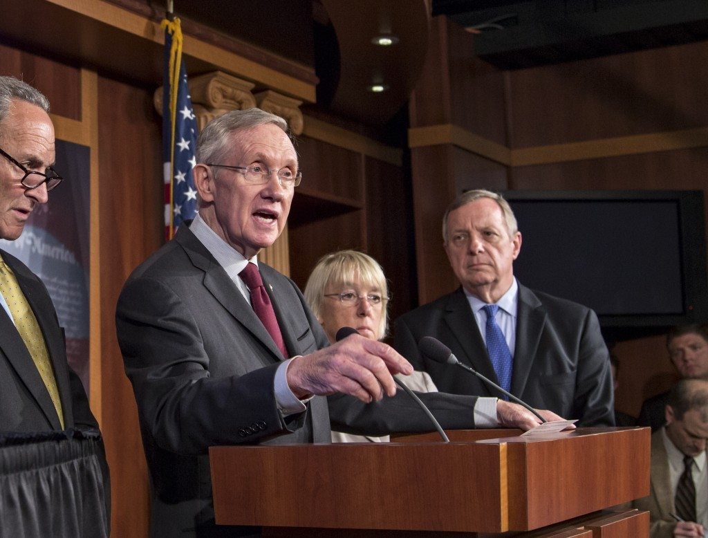 From left, Sen. Chuck Schumer, D-N.Y., Senate Majority Leader Harry Reid, D-Nev., Sen. Patty Murray, D-Wash., chair of the Senate Budget Committee, and Senate Majority Whip Dick Durbin, D-Ill., speak to reporters after the Democratic-led Senate rejected conditions that House Republicans attached to a temporary spending bill, at the Capitol in Washington on Monday.