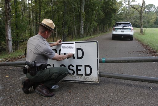 National Park Ranger Robert Turan closes a road Tuesday leading to Wilder Monument at the Chickamauga Battlefield in Chickamauga, Ga., which is among more than 400 parks across the country that have been closed as a result of the federal government's partial shutdown.
