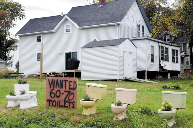 David Labbe is asking for 60 to 70 toilets, in addition to the five already there, to be dropped off on his lawn on Davenport Street in Augusta to protest the City of Augusta's decision to deny a zoning change that would have permitted Dunkin' Donuts to build a store on his property.