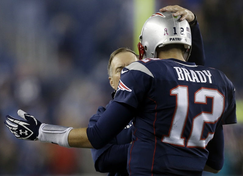 New England Patriots head coach Bill Belichick congratulates quarterback Tom Brady on his winning touchdown pass against the New Orleans Saints in the fourth quarter of an NFL football game Sunday in Foxborough, Mass. The Patriots won 30-27. NFLACTION13;