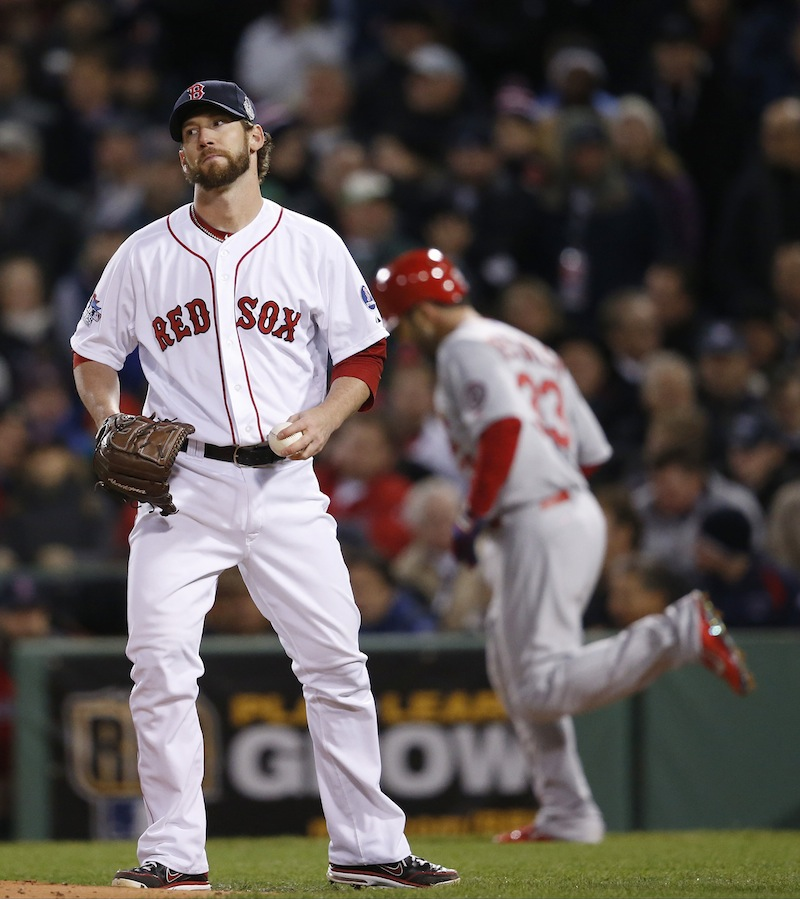 Boston Red Sox relief patcher Craig Breslow reacts after walking St. Louis Cardinals' Daniel Descalso, right, during the seventh inning of Game 2 of baseball's World Series Thursday, Oct. 24, 2013, in Boston. Breslow later made a costly error. MLB