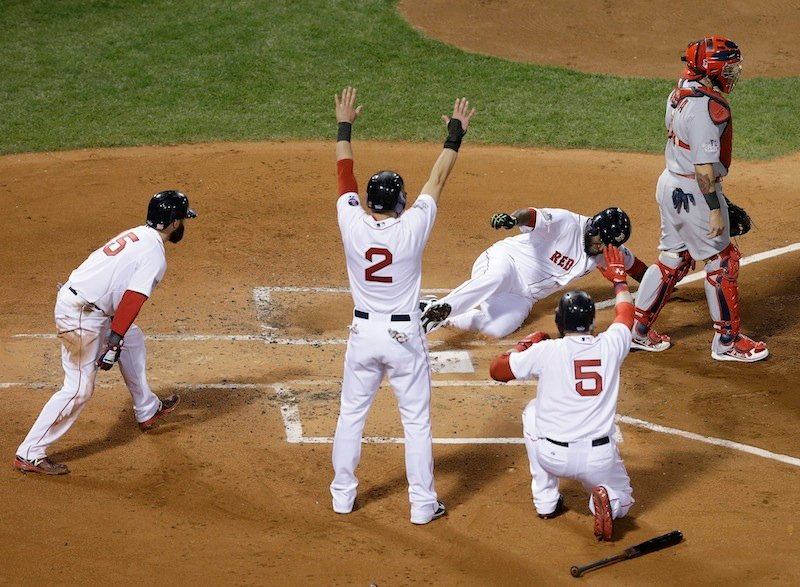 Boston Red Sox's David Ortiz slides home past St. Louis Cardinals catcher Yadier Molina during the first inning of Game 1 of baseball's World Series Wednesday, Oct. 23, 2013, in Boston. Ortiz scored from first on a double by Mike Napoli. MLB