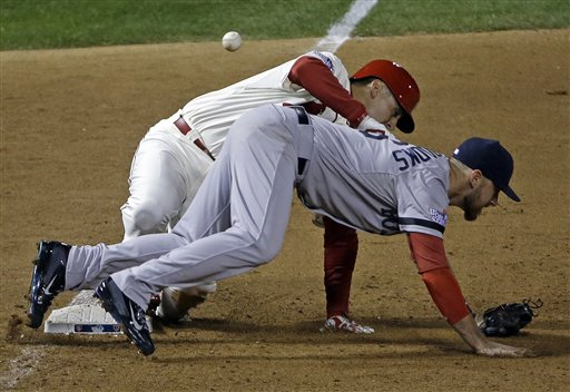 St. Louis Cardinals' Allen Craig gets tangled with Boston Red Sox's Will Middlebrooks during the ninth inning of Game 3 of baseball's World Series Saturday, Oct. 26, 2013, in St. Louis. Middlebrooks was called for obstruction on the play and Craig went in to score the game-winning run. The Cardinals won 5-4 to take a 2-1 lead in the series. (AP Photo/David J. Phillip) MLB