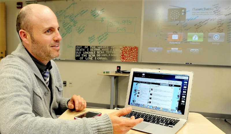 Mt. Blue High School English teacher Dan Ryder explains how he uses Twitter to exchange teaching ideas with other professionals using both a tablet and Smartphone. Some of the lessons on board in background came from his research.