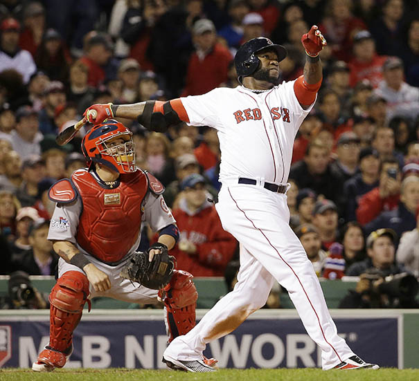 Cardinals catcher Yadier Molina watches as Boston's David Ortiz hits a two-run home run during the seventh inning of Game 1 of the World Series Wednesday in Boston.