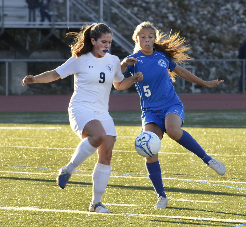 Yarmouth's Abby Belisle-Haley, left, and Falmouth's Georgia Babikian battle for the ball in Monday's Western Maine Conference girls' soccer game. Falmouth won 3-1 at Yarmouth.