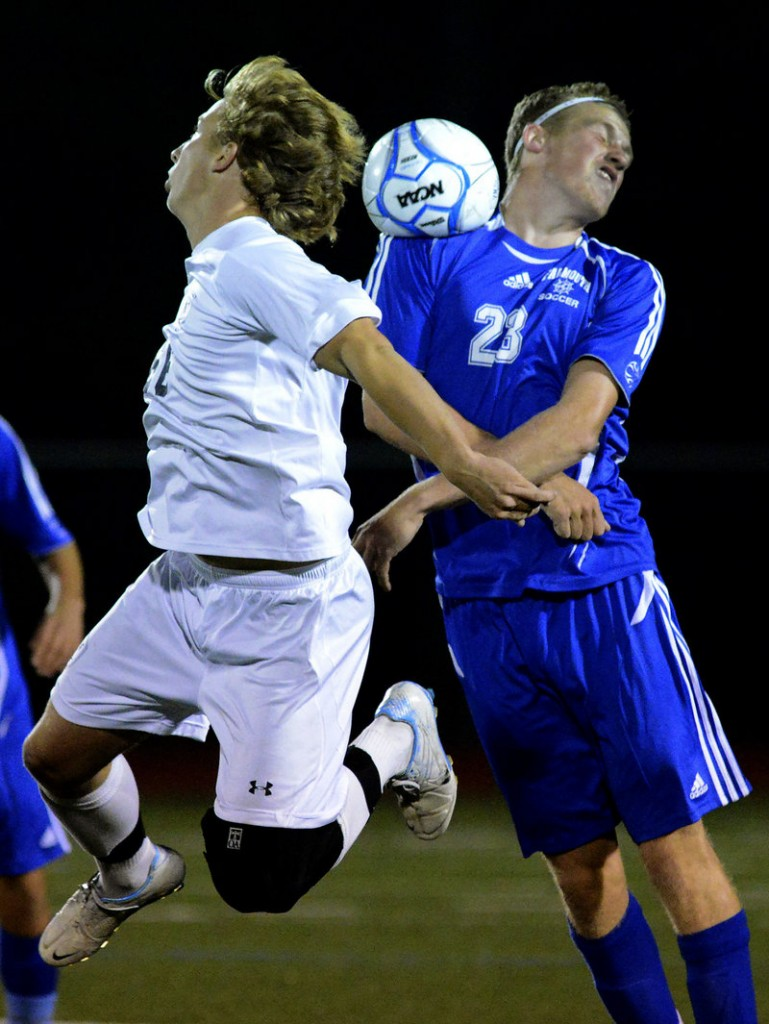 Yarmouth's Wyatt Jackson, left, and Falmouth's Nick Burton battle for a head ball during Yarmouth's 1-0 win at home on Monday night. Yarmouth improved to 6-0-2 with the win, while Falmouth fell to 3-2-2.