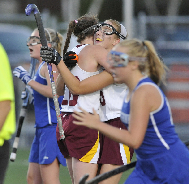 Taylor Herrera, right, gets a hug from teammate Megan Nicholson after scoring the only goal in Cape Elizabeth's 1-0 victory over Kennebunk on Tuesday.