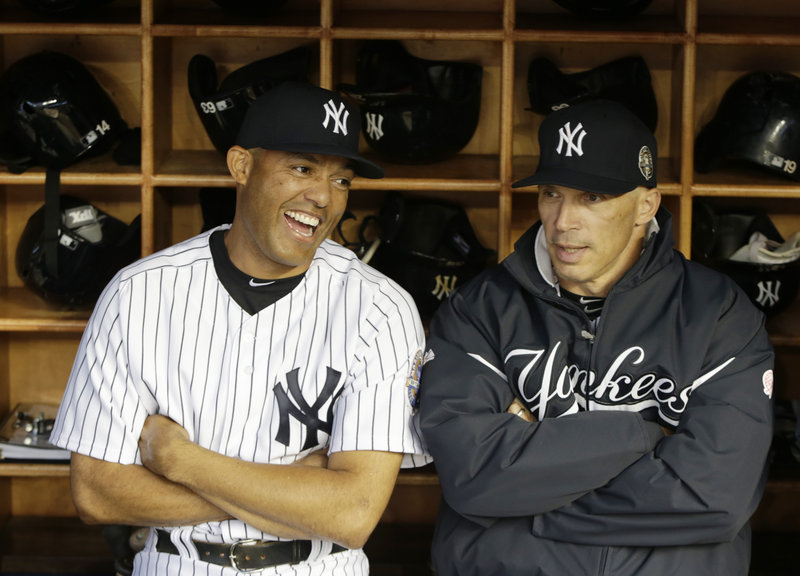 New York Yankees retiring closer Mariano Rivera shares a laugh with manager Joe Girardi. The Yankees want Girardi to continue managing the team even after this disappointing season.