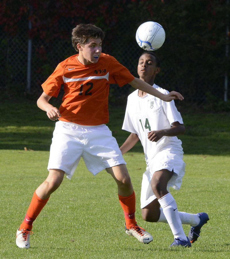 Greyson Cohen of North Yarmouth Academy attempts to keep the ball away from Abel Alemayo of Waynflete during NYA's 1-0 victory in Portland.
