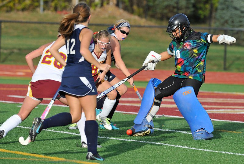 Westbrook goalie Nicole Miranda blocks a shot, only to have Thornton Academy's Libby Pomerleau, center, knock the ball into the net for the first goal of the game Friday. The Trojans scored twice in the second half for a 2-0 win.