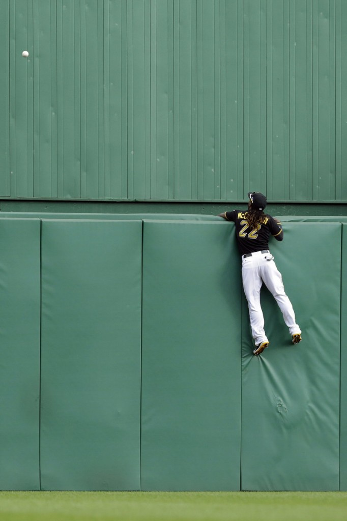 Center fielder Andrew McCutchen watches in vain as Matt Holliday's two-run homer provides the St. Louis Cardinals with all the offense they needed to nip Pittsburgh.