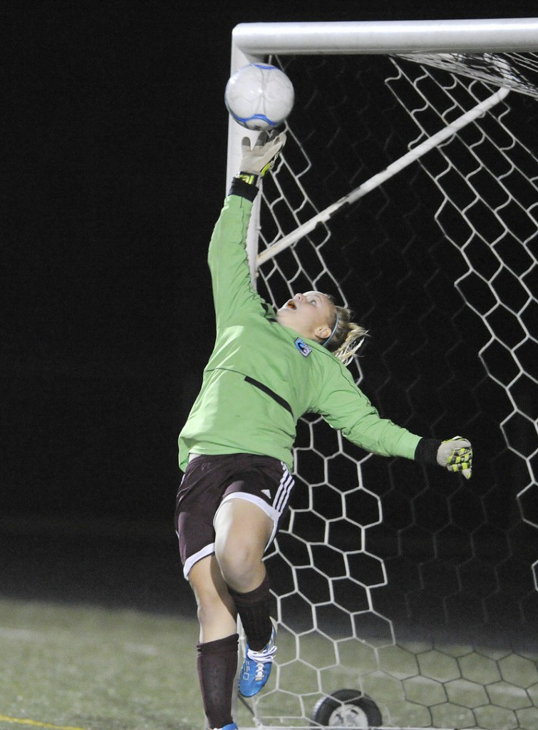 Gorham goalie Renae Staples leaps high, but can't reach the winning goal by Scarborough's Ashley Perriello Monday.
