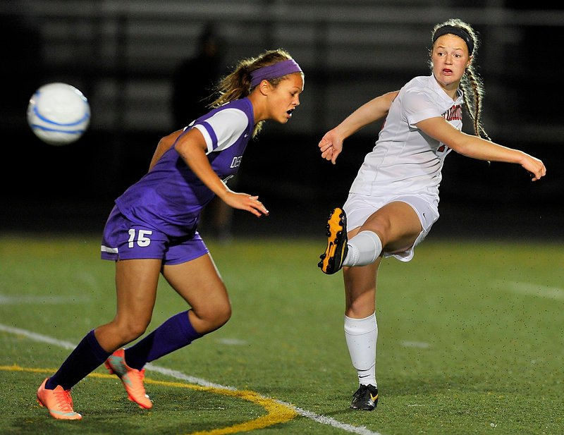 Sam Sparda, who scored the first goal for Scarborough, kicks the ball past Simone Lauture of Deering. Scarborough won, 2-1.