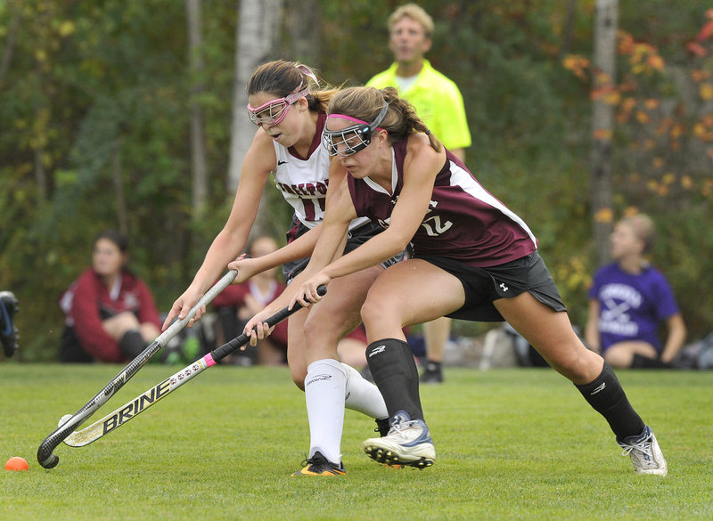Dani Foster, left, of Freeport battles for possession of the ball with Brennah Marin of Greely. Greely forced overtime with a penalty goal after regulation time expired and won in overtime, 2-1.