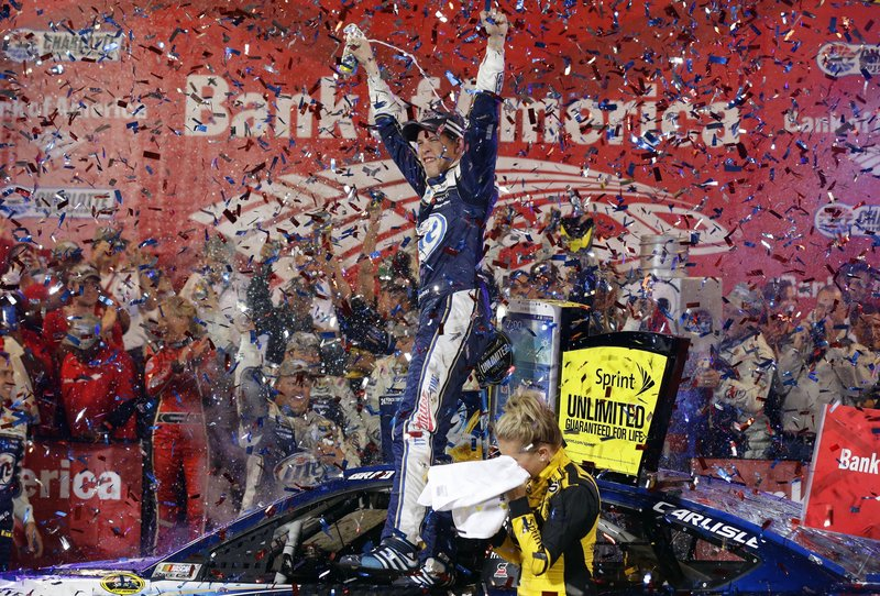 Brad Keselowski celebrates amid a cloud of confetti after winning the NASCAR Sprint Cup Series race at Charlotte Motor Speedway in Concord, N.C., on Saturday night.