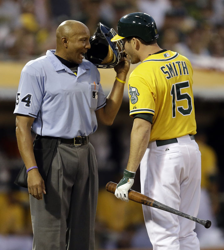 Seth Smith of Oakland may have wanted a word with the umpire early in the game, but the A's were celebrating late, scoring in the ninth to beat Detroit 1-0 and even the series.