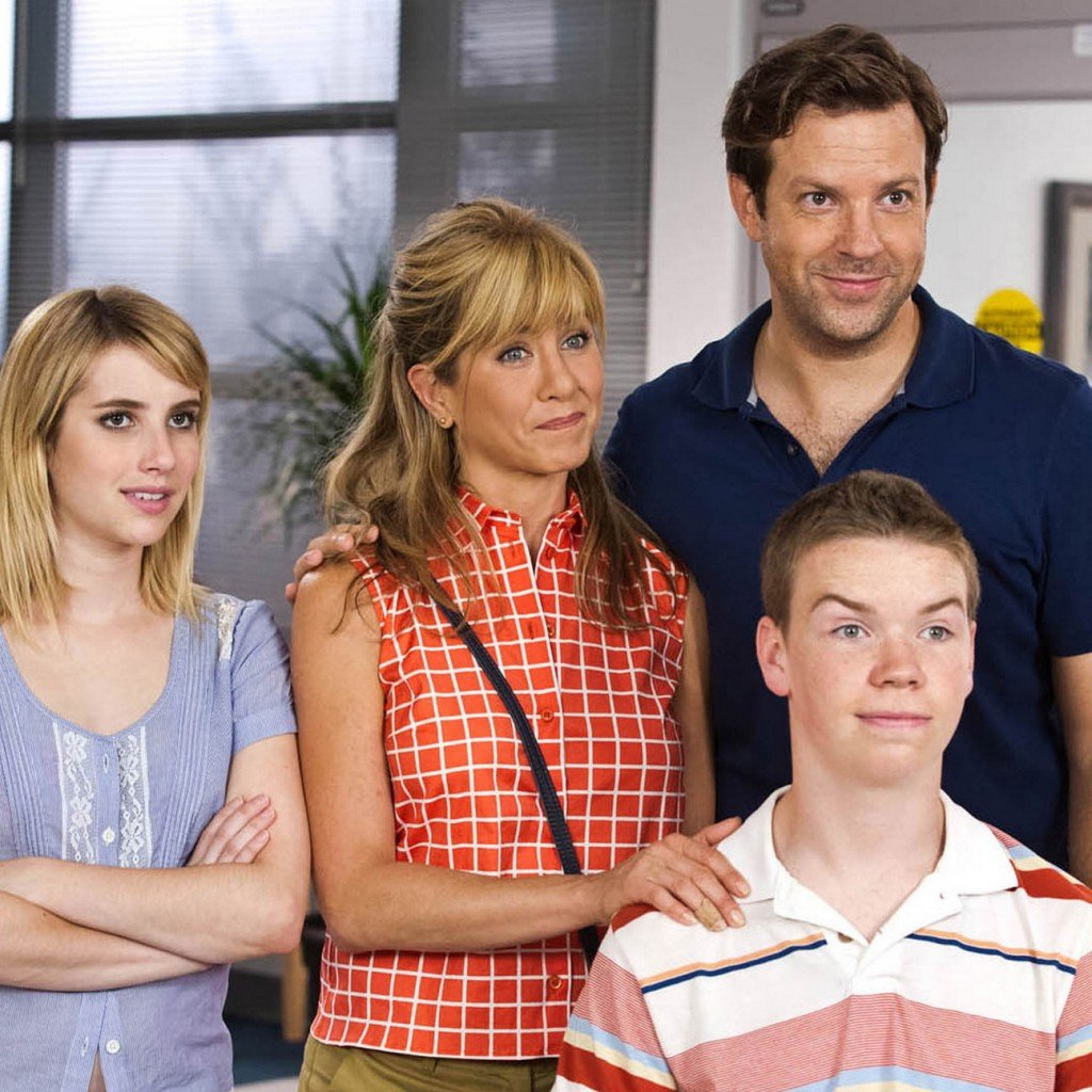 "Emma Roberts, Jennifer Aniston, Jason Sudeikis and Will Poulter in ""We're the Millers."""