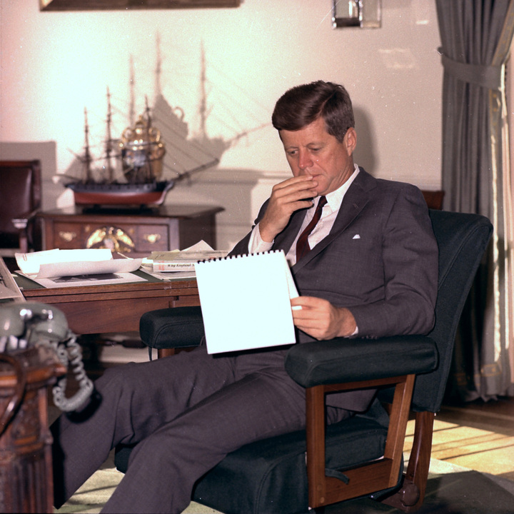 In this Jan. 18, 1962 file photo, U.S. President John F. Kennedy looks over notes at his desk in the White House.