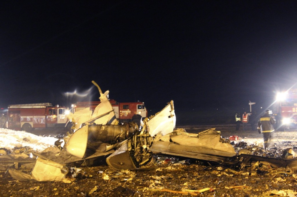 In this photo provided by Russian Emergency Situations Ministry, firefighters and rescuers work at the crash site of a Russian passenger airliner near Kazan, the capital of the Tatarstan Republic, about 450 miles east of Moscow, on Sunday.