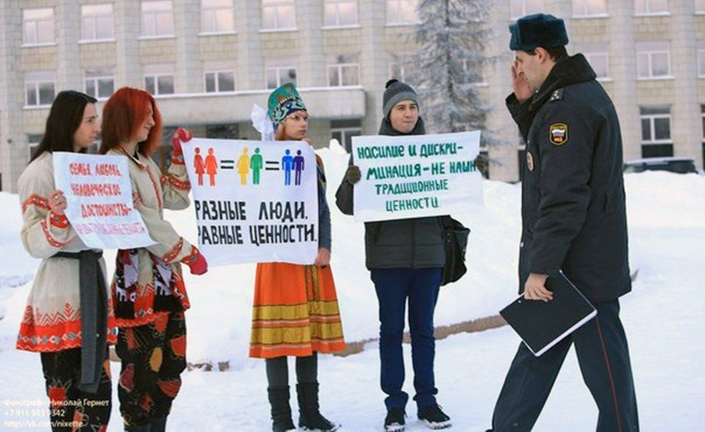 "Photo courtesy Perspective Gay rights activists protest in Archangelsk, Russia, in this undated photo provided by Perspective, a gay rights group in Archangelsk. The city in northern Russia is the sister city of Portland. Two members of Perspective will be in Portland this week as part of a trip funded by Human Rights First. The sign in the center says ""Different People, Equal Value."" The sign on the right says, ""Violence and Discrimination are Not Traditional Values."""