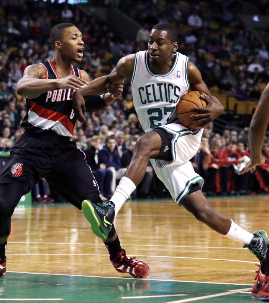 Guard Jordan Crawford drives to the basket against Portland guard Damian Lillard during Friday's game in Boston, won by the Trail Blazers, 109-96.