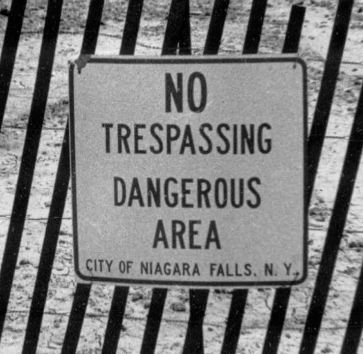 This Aug. 2, 1978, file photo shows a fence and a sign cordoning off a contaminated toxic waste dump site in the Love Canal neighborhood of Niagara Falls, N.Y. With Love Canal getting national attention, President Jimmy Carter in 1978 issued a disaster declaration that eventually led to evacuation and compensation for more than 900 families. The crisis also led to federal Superfund legislation to clean up the nation's abandoned waste sites.