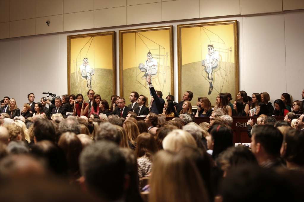 "This photo provided by Christie's shows the bidding during the auction for the 1969 painting by Francis Bacon, ""Three Studies of Lucian Freud"" in New York. The painting sold for $142 million."