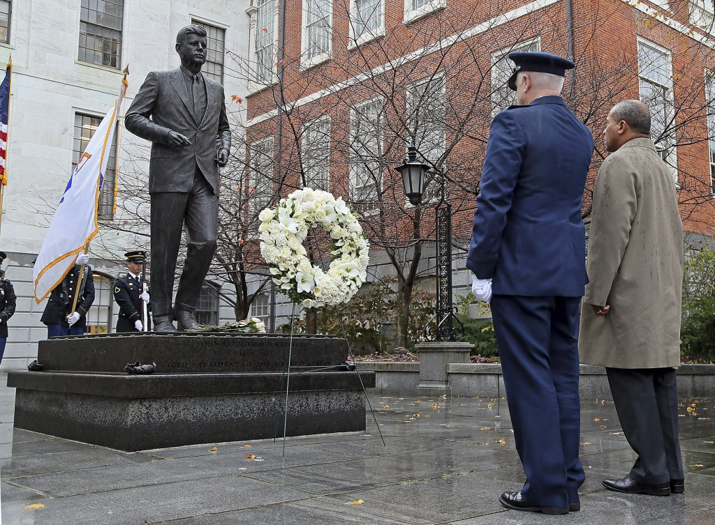 Gov. Deval Patrick, right, and L. Scott Rice, Adjutant General of the Massachusetts National Guard, lay a wreath at the State House statue of President John F. Kennedy, Friday, Nov. 22, 2013, in Boston. Kennedy, the 35th President of the United States, was assassinated in Dallas 50 years ago today.