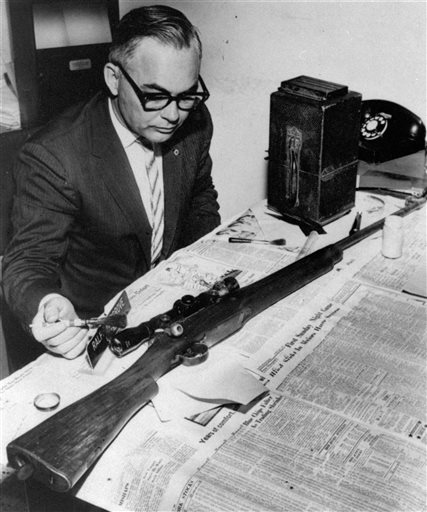 In this June 12, 1963 file photo, Jackson Police Capt. Ralph Hargrove, chief of the Identification Bureau, poses with .30 caliber rifle which police say was used to kill Medgar Evers. Evers was field secretary for the NAACP and was shot at his Jackson, Miss. home. The weapon was found in some weeds nearby.