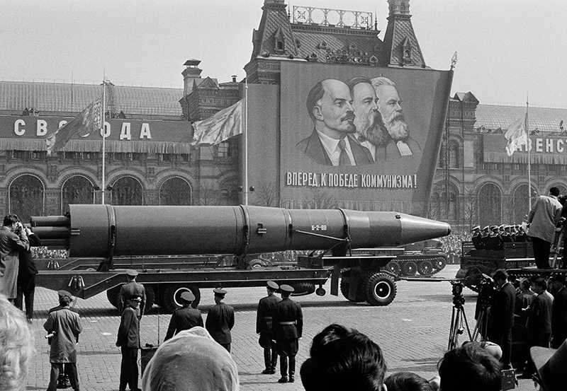 In this May 1, 1963 file photo, a naval rocket is exhibited in Moscow's Red Square past a banner of Vladimir Lenin, Friedrich Engels and Karl Marx during the annual May Day parade in the Soviet Union. Under the shadow of the Cold War's threat of