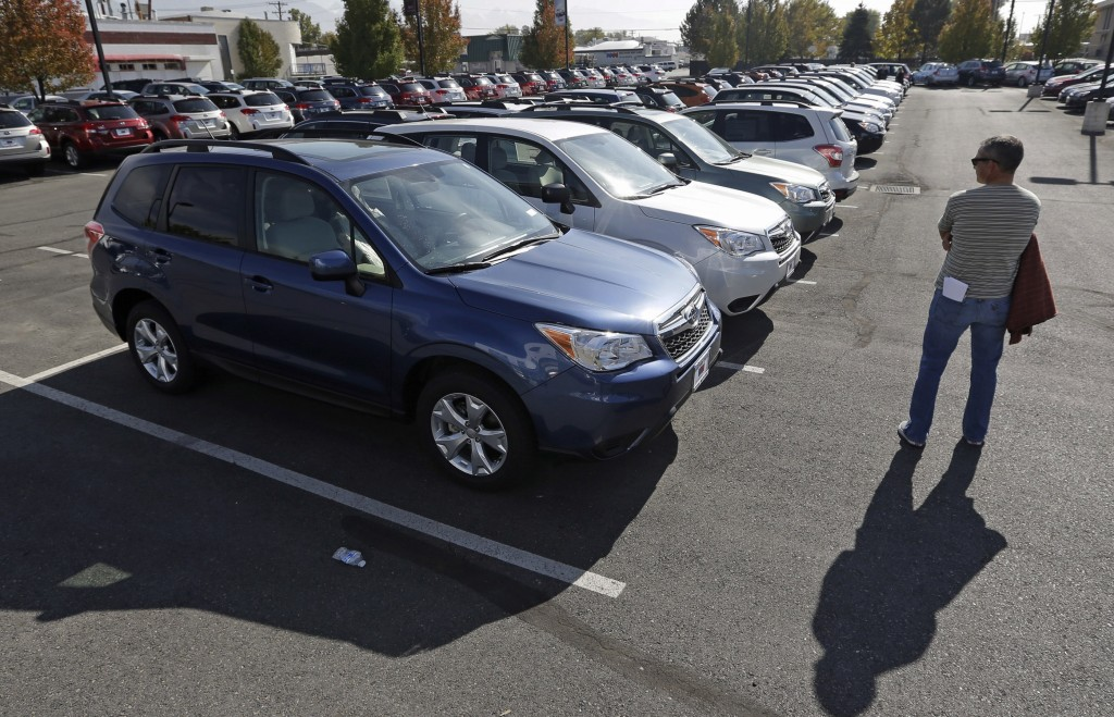 Subaru Foresters on a lot at Salt Lake City and other crossovers offer better gas mileage than full-size SUVs but have more interior room than the compact cars on which they are based.
