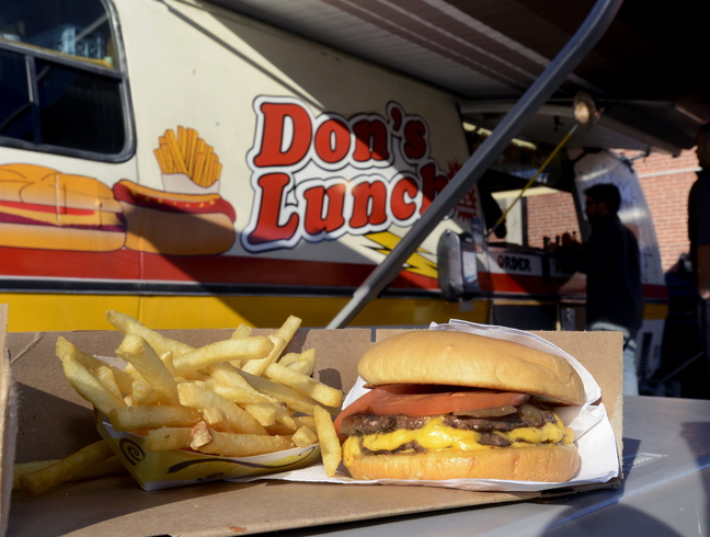 "The double cheeseburger, called ""The Big One,"" and french fries served at Don's Lunch on Main Street in Westbrook."