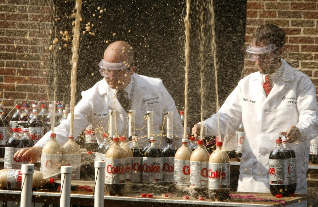 """Stephen Voltz, left, and Fritz Grobe, both of Buckfield create a geyser effect from a combination of diet soda and Mentos mints during a taping of """"Late Show with David Letterman"""", in New York. The Associated Press"""