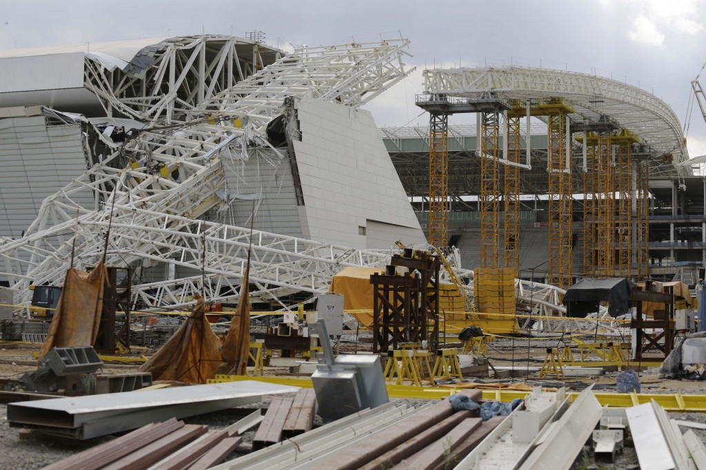 A metal structure that buckled sits on part of the Itaquerao Stadium in Sao Paulo, Brazil, on Wednesday. Part of the stadium that will host the 2014 World Cup opener in Brazil collapsed, causing significant damage and killing at least two people, authorities said.