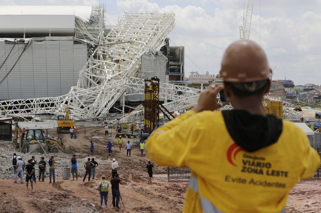 A metal structure sits atop the Itaquerao Stadium after a collapse in Sao Paulo, Brazil, on Wednesday.
