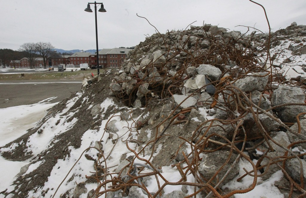 Rubble is piled where the Osgood Building stood at the state office complex in Waterbury, Vt. The complex was damaged by flooding.