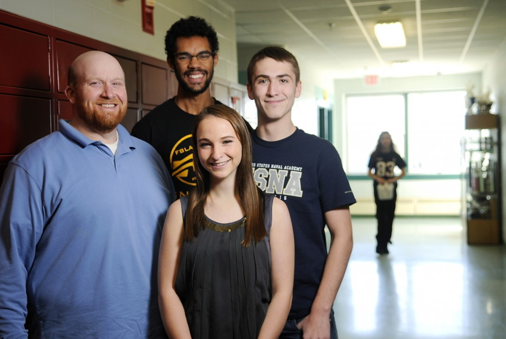 Monmouth Academy teacher Scott Wing, left, and National Honor Society students Angus Kollen, right, Ashley Coulombe and Marcques Houston plan to start a food bank run by students at the school.