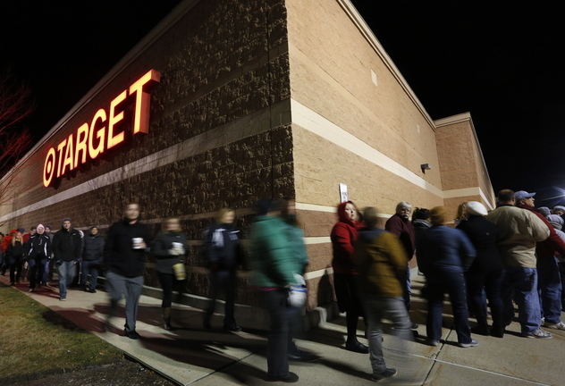 Black Friday shoppers move up a few spaces in a line that wrapped around Target in South Portland shortly before the store opened at midnight on Friday.