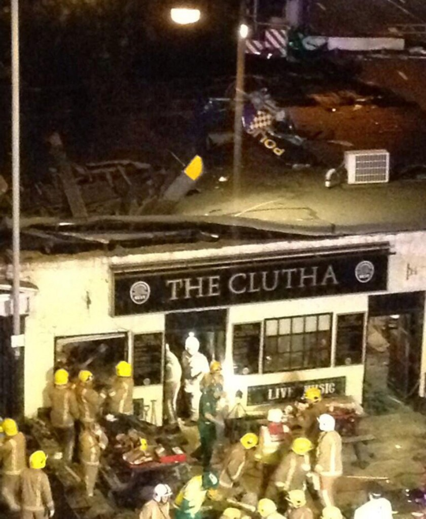 A picture taken with permission from Jan Hollands' Twitter feed, JanHollands@Janney_h, shows the helicopter crash at the Clutha Bar in Glasgow on Friday.