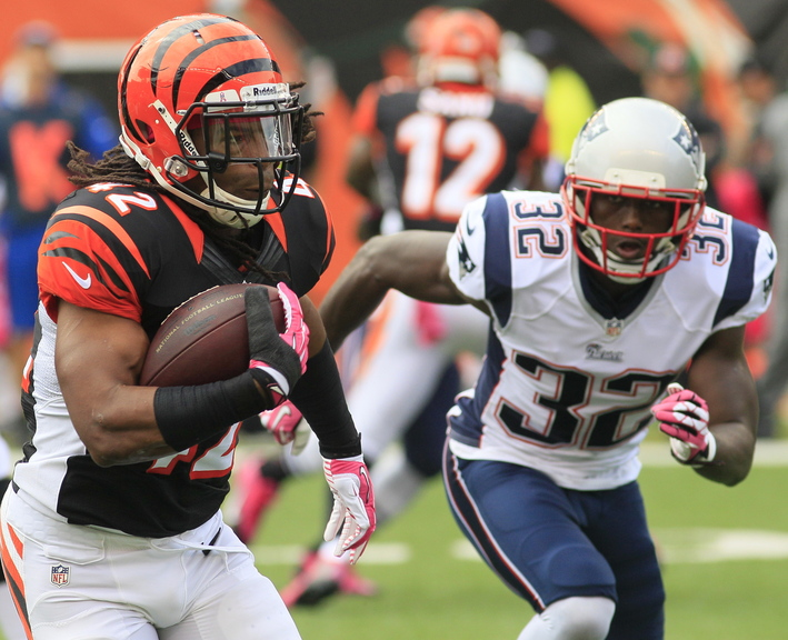 Cincinnati's BenJarvus Green-Ellis is hotly pursued by New England free safety Devin McCourty, a former first-rate cornerback thriving in his new position in the Patriots' defensive backfield.