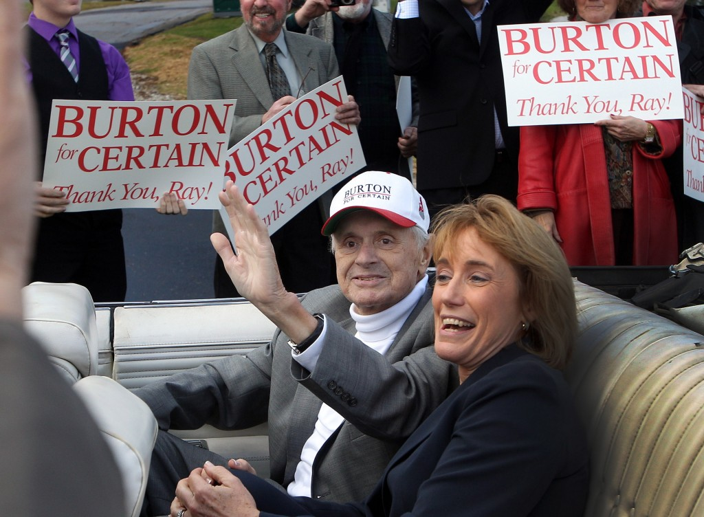 Riding with New Hampshire's Gov. Maggie Hassan, Executive Councilor Ray Burton waves to supporters Friday in Bretton Woods, N.H., as he arrives for a an opening ceremony at a scenic overlook dedicated to him. Burton is a staunch advocate for northern Vermont.