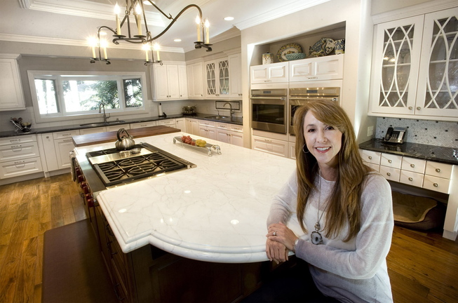 Michelle Christy's recently remodeled kitchen in North Tustin, Calif., features a large island and new appliances plus three sinks.